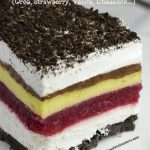 Image of a layered dessert with crushed Oreos on a plate