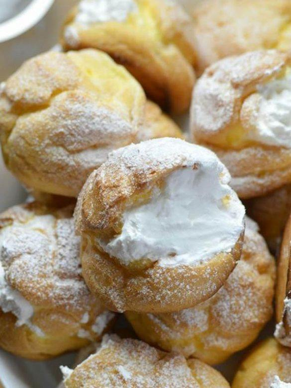 Cream puffs on white plate