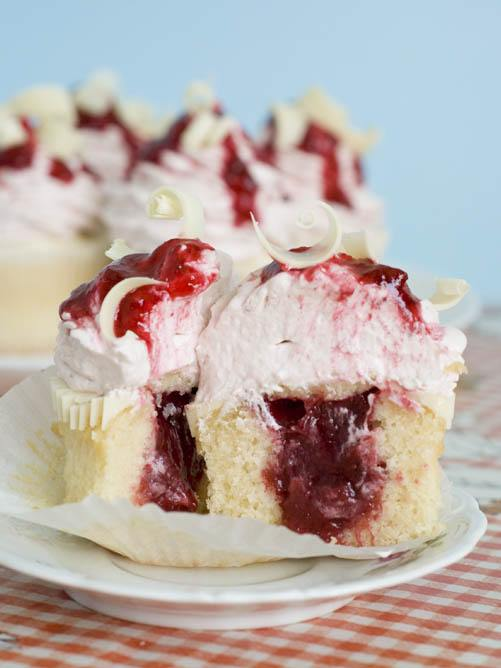 White Chocolate Strawberry Jam Cupcakes sliced in half