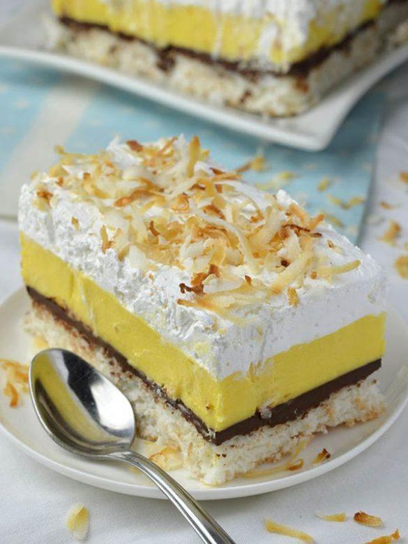 Slice of Dreamy Creamy Coconut Bars on white plate