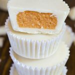 Stack of white chocolate pumpkin cups