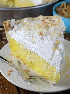 Slice of Coconut Craam Pie on white plate.