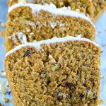 Slices of carrot cake banana bread with cream cheese frosting