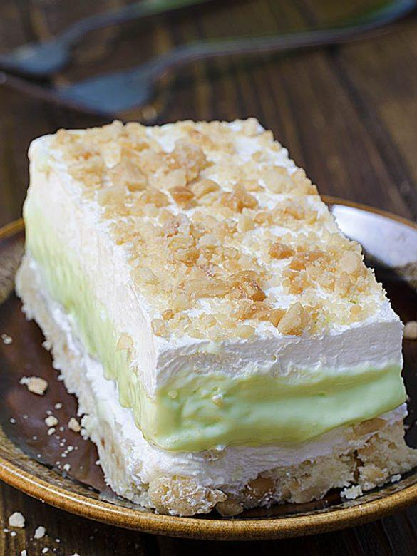 Big piece of Key Lime Pie Lasagna on a brown plate.