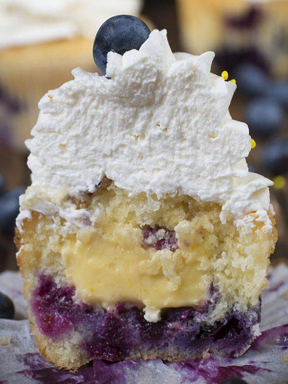 Blueberry Cupcakes sliced on a half showing lemon curd inside.