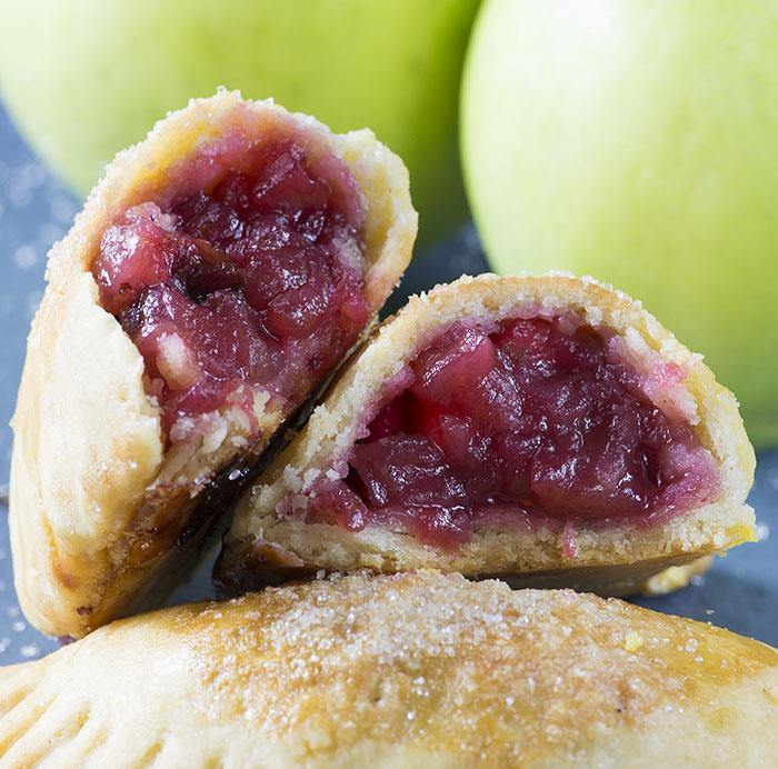 Cranberry Apple Empanadas - cranberry and apple pie filling wrapped in flaky buttery crust.