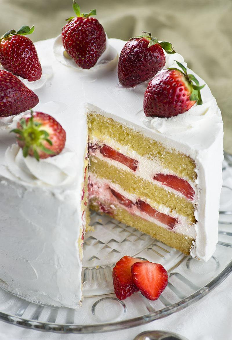 Strawberry Shortcake Recipe- layers of dense, buttery and moist vanilla cake filled with fresh whipped cream and fresh sliced strawberries. Easy spring ( or summer ) dessert recipe to celebrate the arrival of my favorite season.