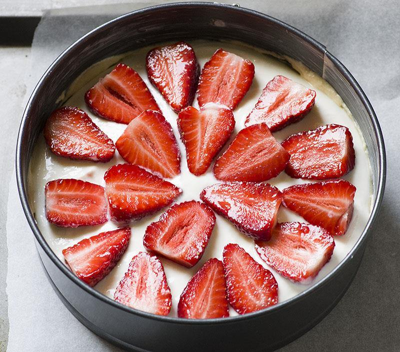 Strawberry Cheesecake Coffee Cake-one cake with seven irresistible layers - buttery and moist, vanilla crumb cake, creamy cheesecake filling, juicy strawberries, another cake layer topped with sliced strawberries, crumb topping and sweet vanilla glaze.