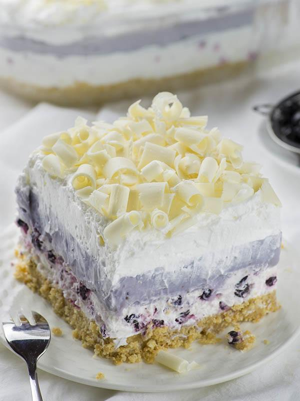 A piece of Blueberry Lasagna served on white plate.