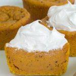 Sliced in half OMG Pumpkin Pie Cupcakes Made with Homemade Pumpkin Puree.