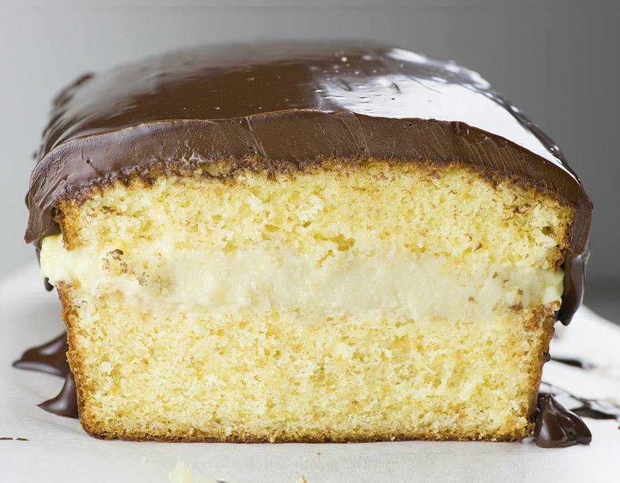 Boston Cream Pie Pound Cake - magnificent, smooth and creamy filling with vanilla flavor sandwiched between two cake layer, topped with rich chocolate ganache! Winning combo!