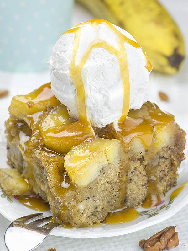 Piece of Banana Upside Down Cake with ice cream on top.