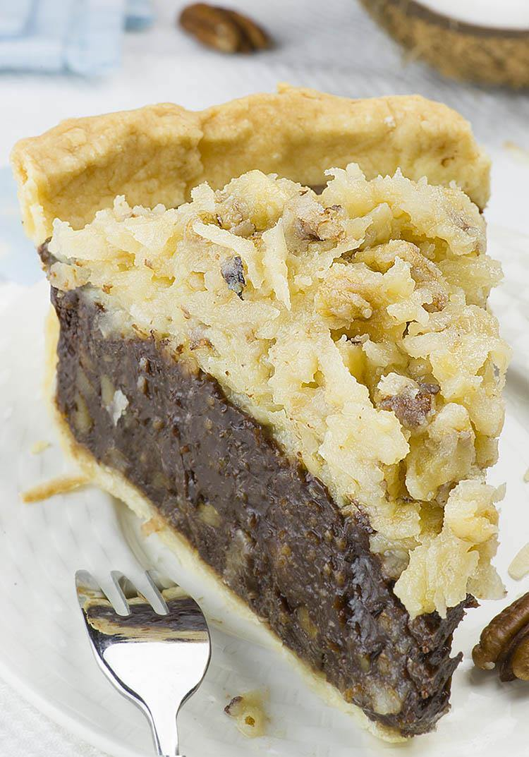 German Chocolate Pie is melt-in-your-mouth dessert with rich and fudgy, flourless chocolate filling and classic coconut - pecan topping.