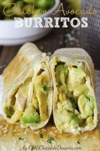 Two pieces Chicken Avocado Burritos in front of avocado bowl.