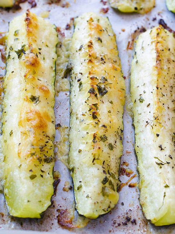 Three pieces of Baked Parmesan Zucchini on a baking paper.