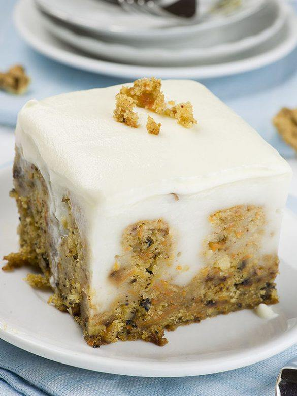 Piece of Carrot Cake Poke Cake on a plate