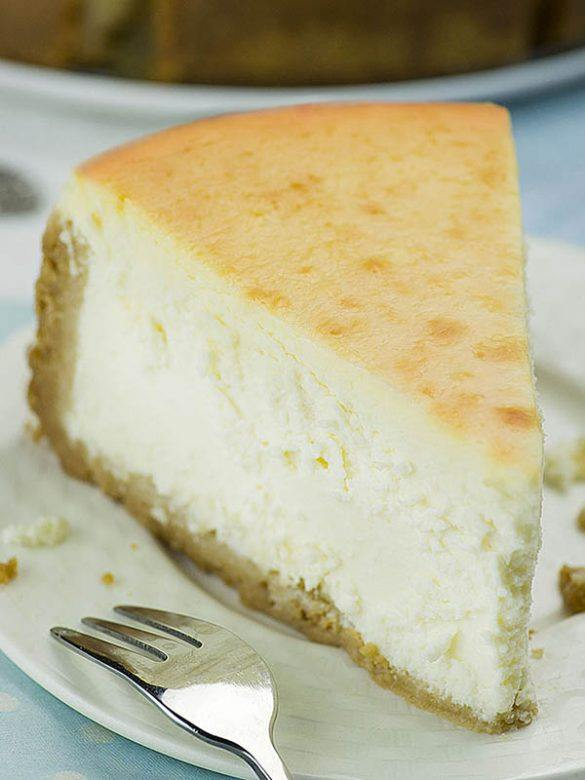 Slice of New York Style Cheesecake on a plate.