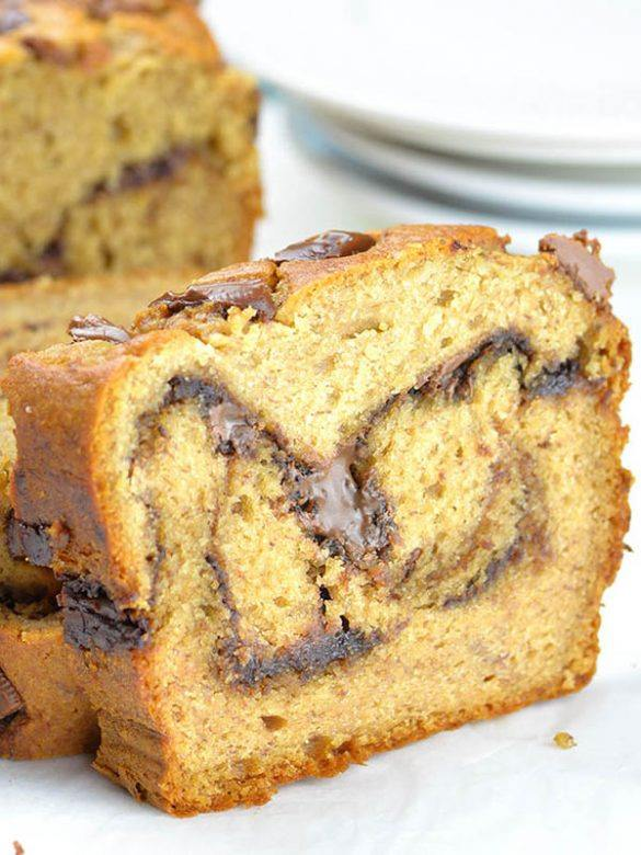 Sliced loaf of Peanut Butter Banana Bread with Nutella Swirl