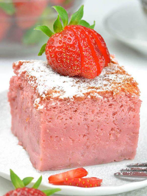 Strawberry Custard Cake piece on plate with strawberry on top.