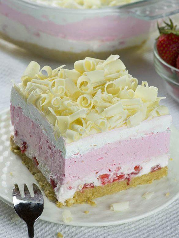 No Bake Strawberry Jello Lasagna slice in white plate!