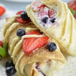 Two oven baked berry cheesecake chimichangas