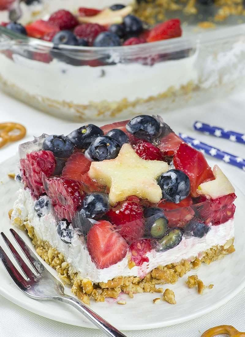 Piece of No Bake Summer Berry Pretzel Salad on a white plate.