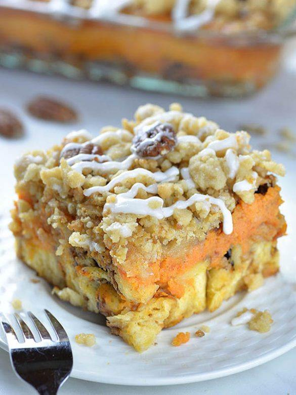 Pumpkin Pie Cinnamon Roll Casserole slice on a white plate.