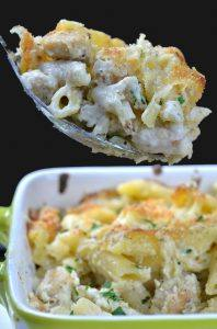 Chicken Alfredo Bake in big spoon over the casserole.