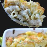 Pan and spoon full of chicken alfredo casserole
