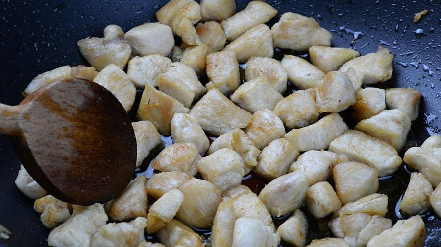 Small chicken pieces in a pan.