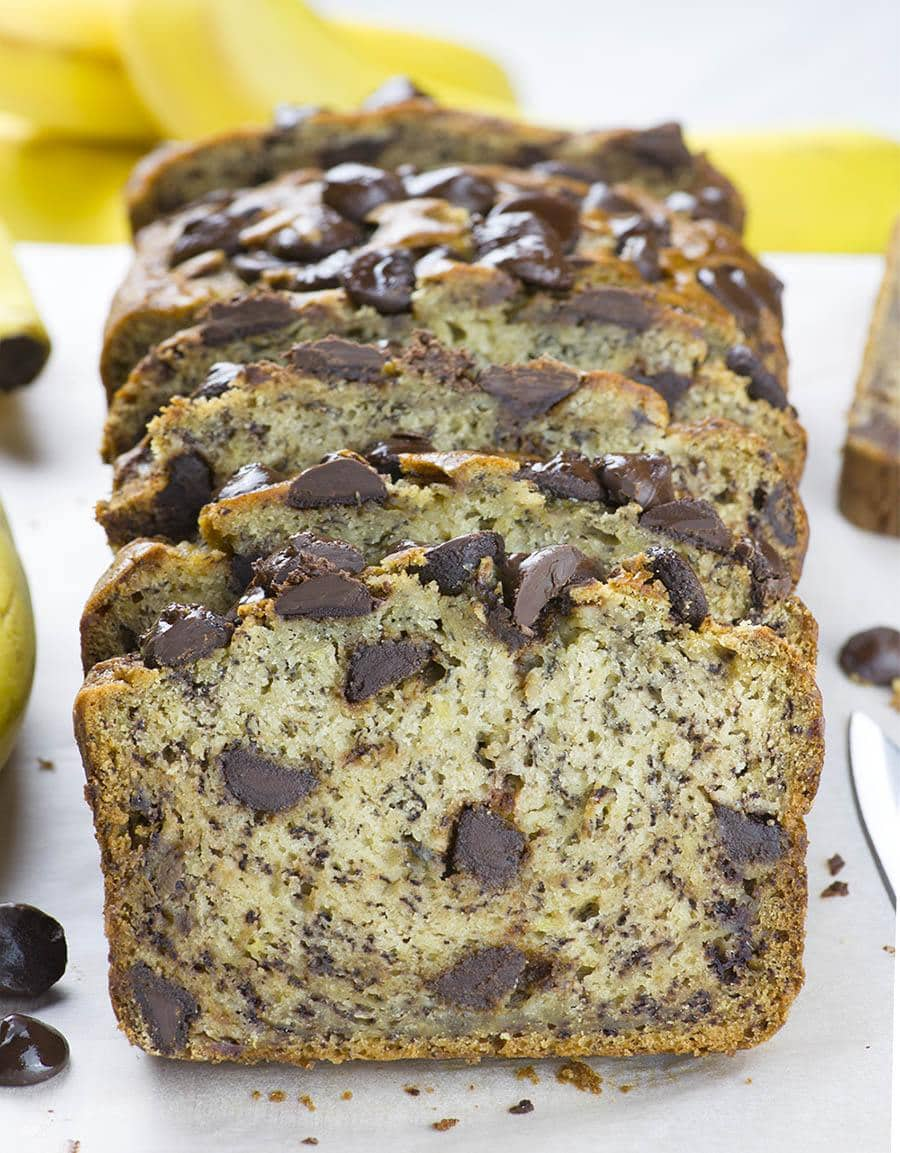 Sliced Chocolate Chip Banana Bread with one slice of bread in front of loaf.