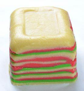 Layers of red, white and green cookie dough for sugar cookies.