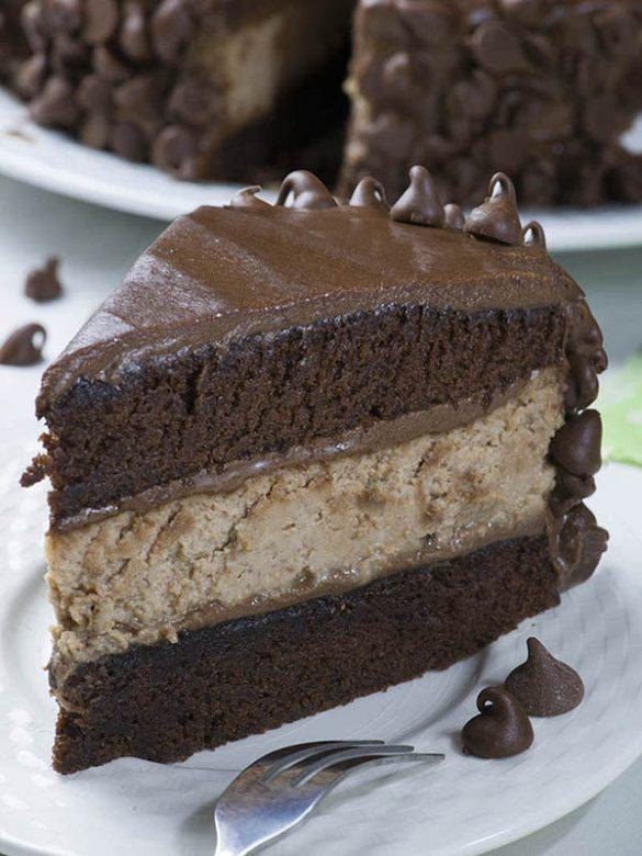 Hershey Cheesecake Chocolate Cake piece on a white plate.