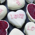 Bunch of red velvet cake Valentine's hearts with love written on them