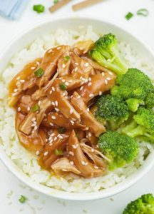 Bowl of Easy Crock pot Teriyaki Chicken with broccoli and rice.