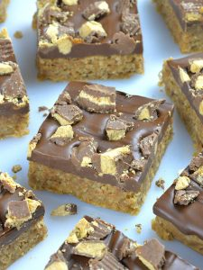 Bunch of Reese's Peanut Butter Oatmeal Bars on a table.