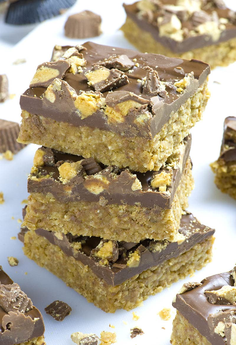 Three pieces of Reese's Peanut Butter Oatmeal Bars on a table.