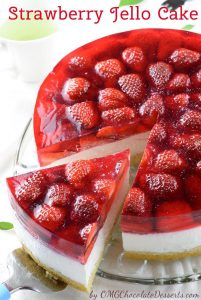 Cut of one piece of strawberry jello cake.