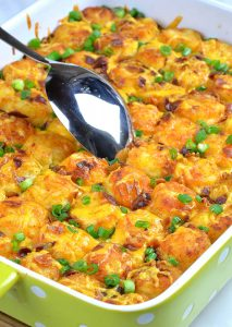 Baked Tater Tot Casserole with big spoon.