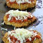 Three pieces of baked chicken parmesan