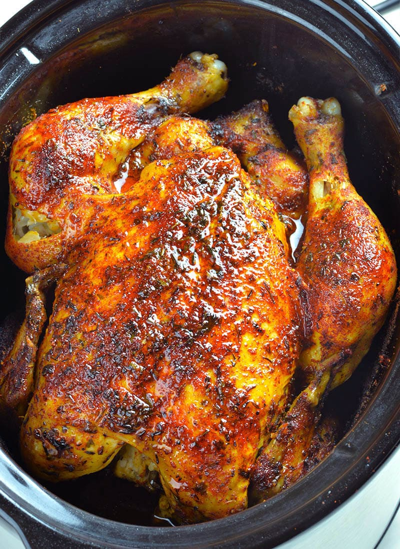 Whole chicken cooked in a slow cooker.
