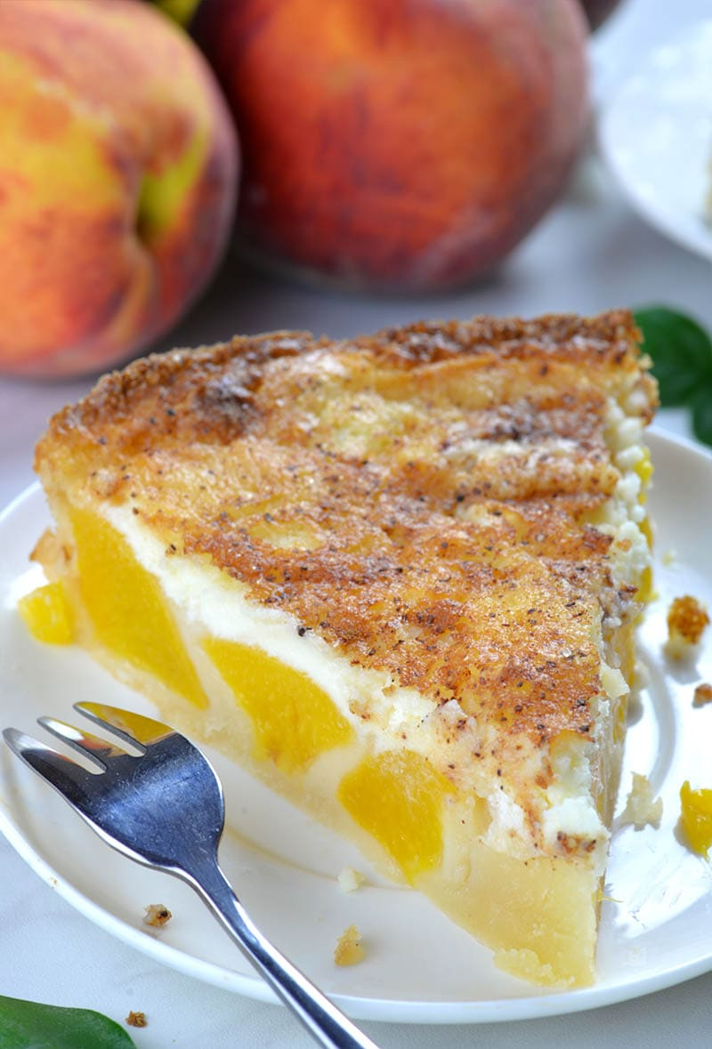 Peaches and Cream Pie Recipe is so simple. To make the batter combine dry ingredients: all-purpose flour, corn starch, baking powder, salt and sugar. Then add butter, egg, milk and vanilla and mix for 2 minutes. Pour the mixture in prepared deep pie dish and arrange canned peaches on top.