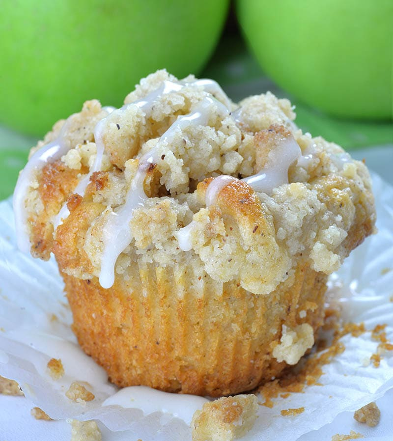 Apple Pie Muffins in front of green apples.