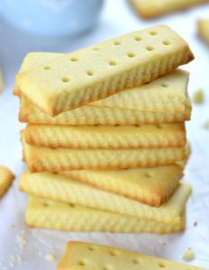 Bunch of rectangular shaped Easy Shortbread Cookies on each other.