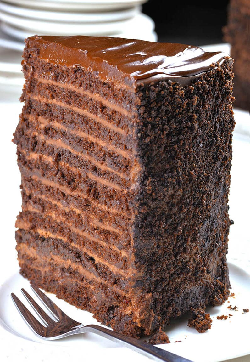 This chocolate cake with 12 layers of cake, 12 layers of filling, plus chocolate ganache on top is real multi-layer chocolate madness!