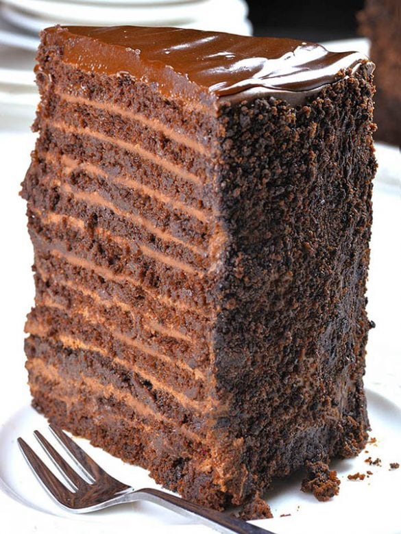 This chocolate cake with 12 layers of cake, 12 layers of filling, plus chocolate ganache on top.