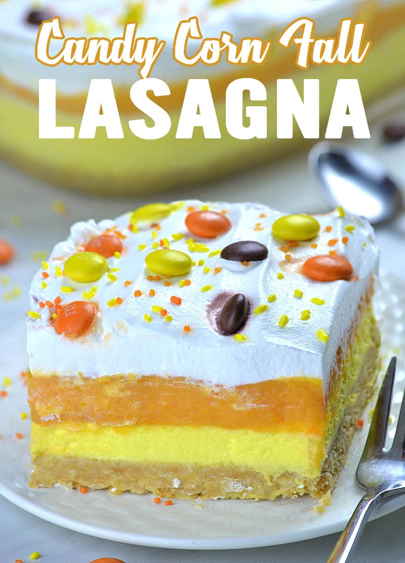 Candy Corn Lasagna - piece of layered dessert on white plate. Golden Oreo crust and yellow,orange and white layers.