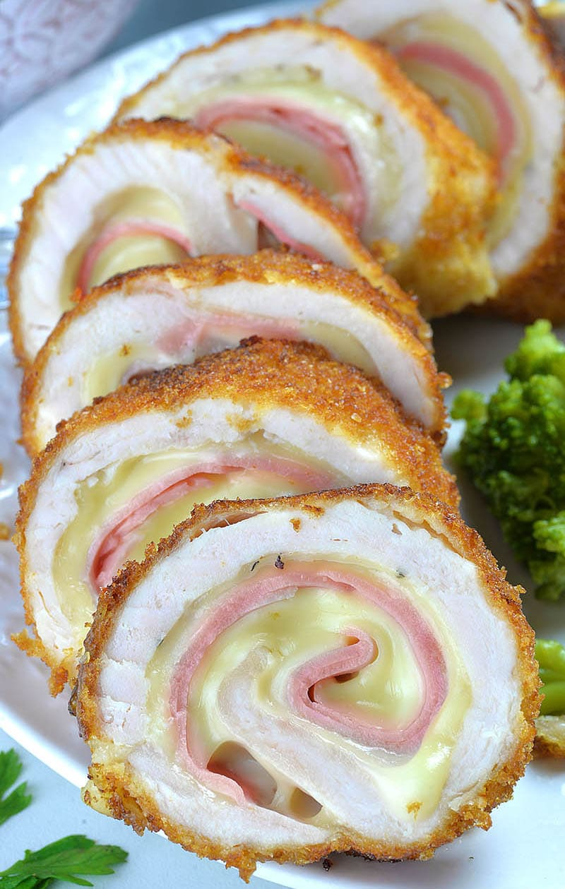 Chicken Cordon Bleu stuffed with ham and cheese, coated with crunchy golden breadcrumbs is easy to make, family favorite chicken recipe.