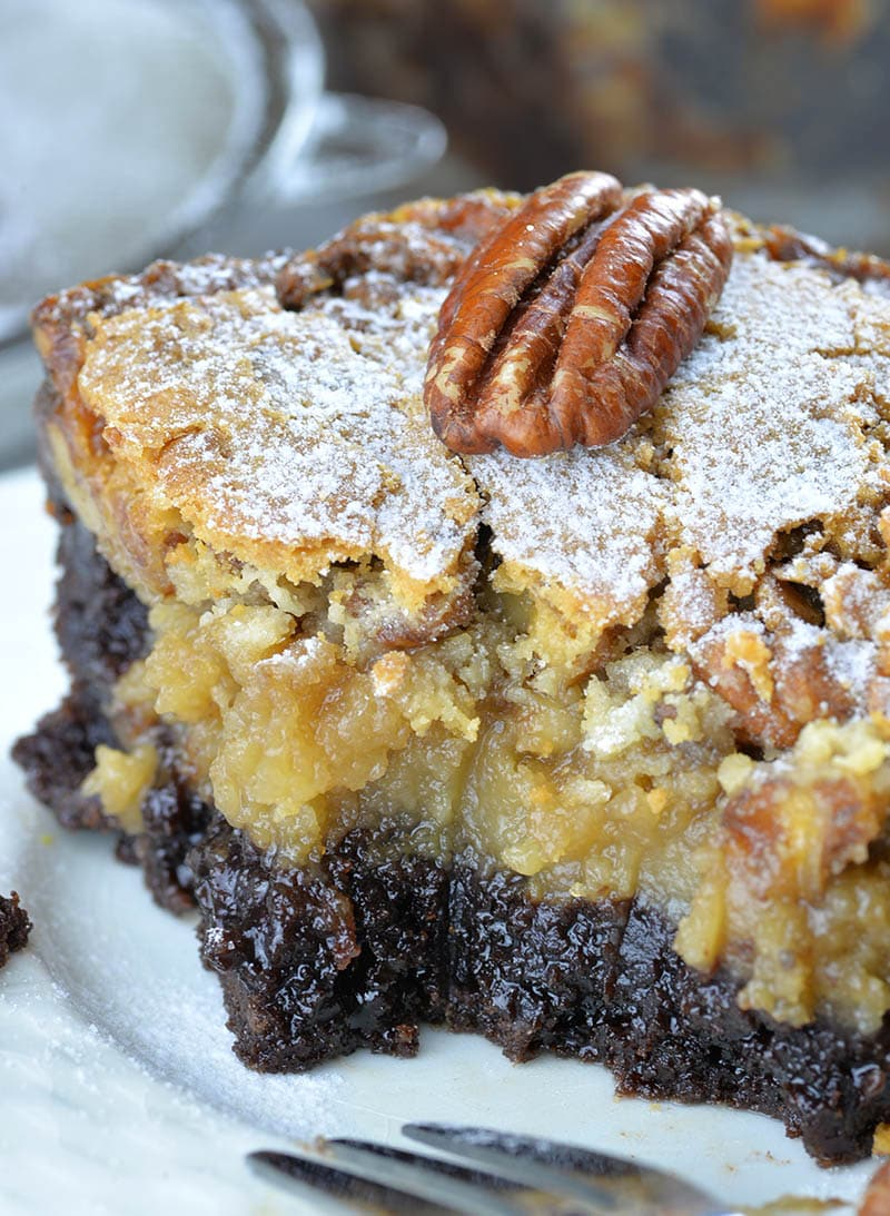 Bitten piece of Chocolate Pecan Ooey Gooey Butter Cake.