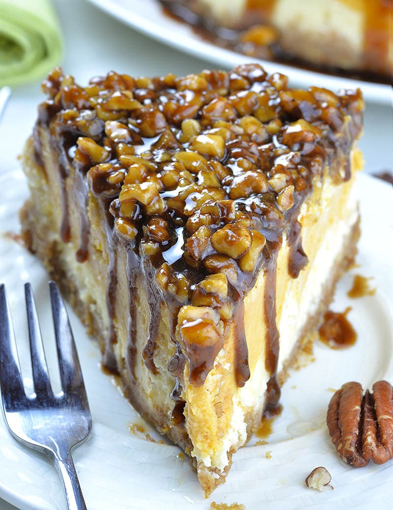 Piece of Sweet Potato Cheesecake with Pecan Topping on a white plate.